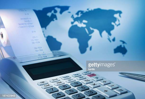 a calculator with a receipt coming out of it - annual event stock pictures, royalty-free photos & images