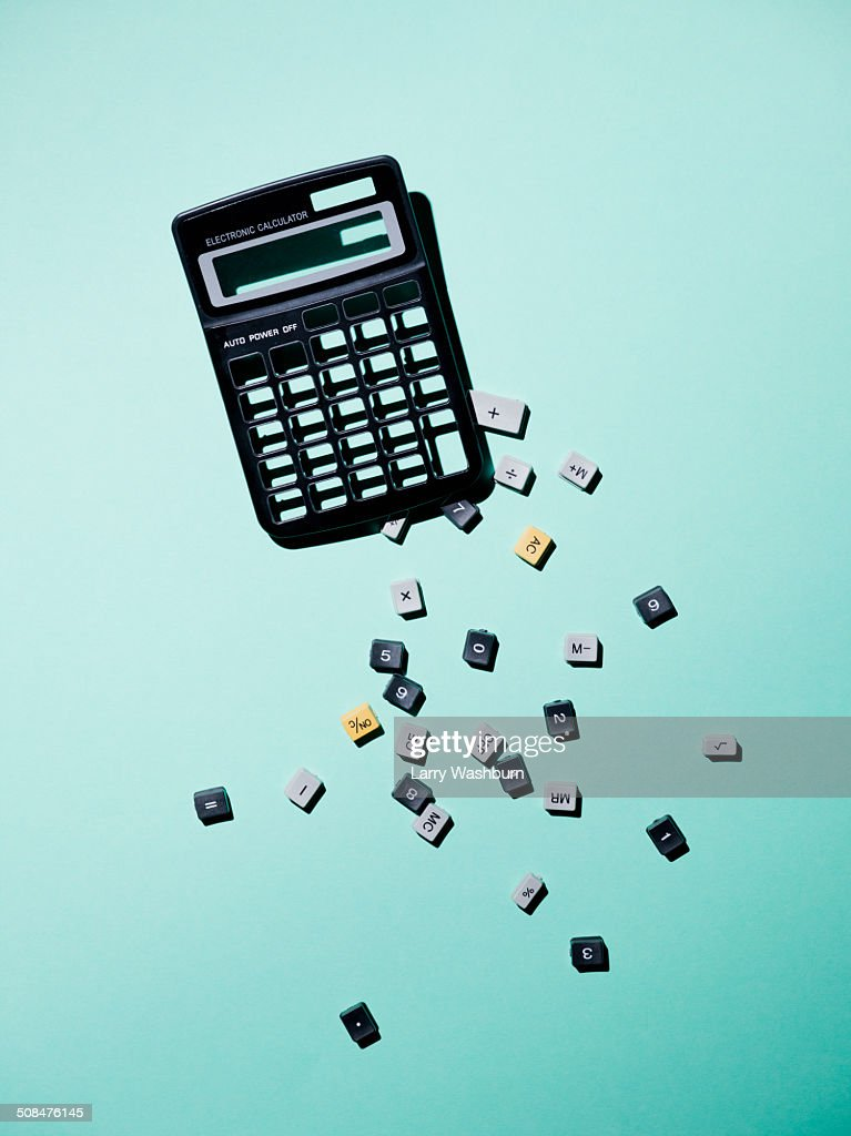 Calculator with broken buttons over blue background : Stock Photo