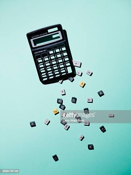 calculator with broken buttons over blue background - calculator stock photos and pictures