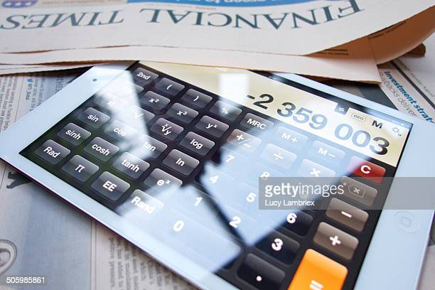 Calculator with negative number next to Financial Times