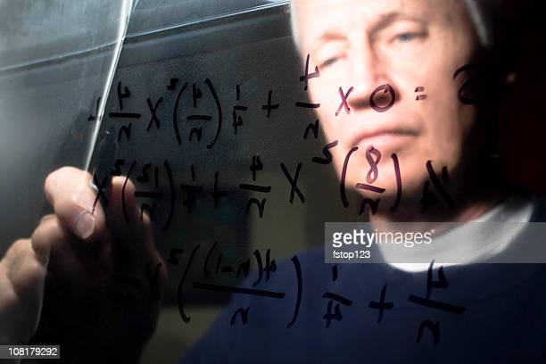 calculus equation on a clear dry erase board with man - acrylic glass stock pictures, royalty-free photos & images