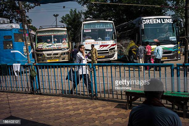 A Calcutta Tramways Company Ltd tram left passes parked buses in Kolkata West Bengal India on Tuesday Oct 29 2013 Asia's thirdlargest economy will...