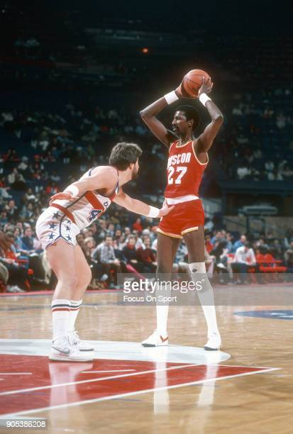 Caldwell Jones of the Houston Rockets looks to pass the ball over the top of Jeff Ruland of the Washington Bullets during an NBA basketball game...