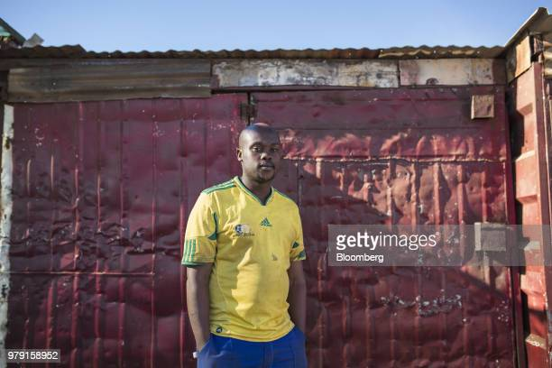 Caldwell Nzimeni a former engineering assistant at AngloGold Ashanti Ltd's Mponeng mine poses for a photograph in Khutsong Carletonville South Africa...