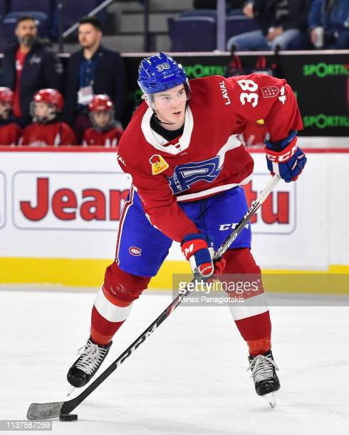 Cale Fleury of the Laval Rocket looks to play the puck during the warmup against the Providence Bruins prior to the AHL game at Place Bell on March...