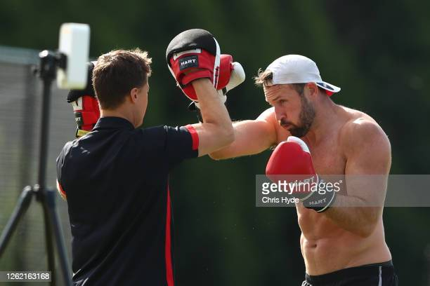 Cale Hooker boxes during an Essendon Bombers AFL training session at Metricon Stadium on July 29, 2020 in Gold Coast, Australia.