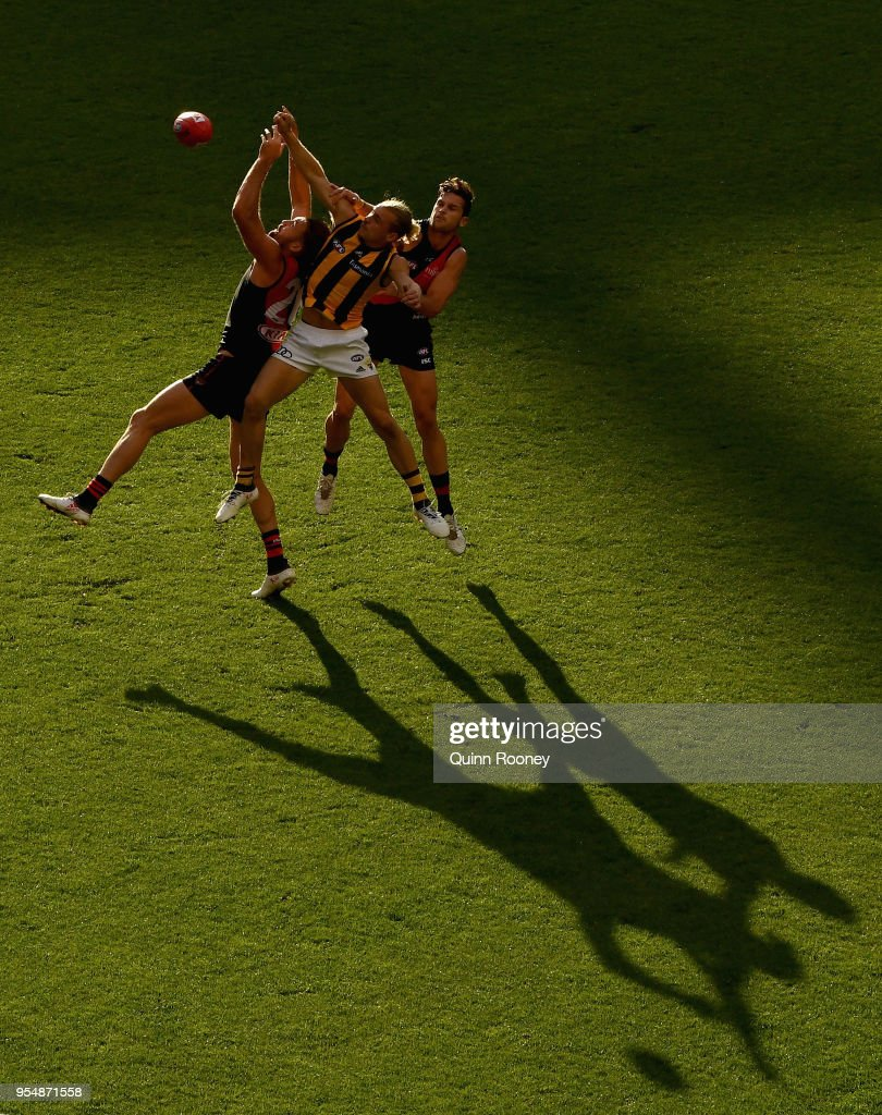 Cale Hooker of the Bombers and James Worpel of the Hawks compete for the ball during the round seven AFL match between the Essendon Bombers and the Hawthorn Hawks at Melbourne Cricket Ground on May 5, 2018 in Melbourne, Australia.