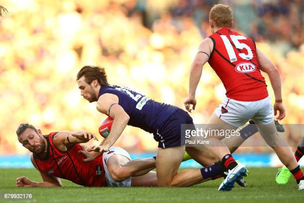 Cale Hooker of the Bombers and Joel Hamling of the Dockers contest for the ball during the round seven AFL match between the Fremantle Dockers and...