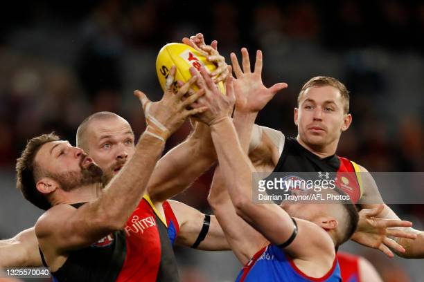 Cale Hooker of the Bombers and Steven May of the Demons compete for the ball during the round 15 AFL match between the Essendon Bombers and the...