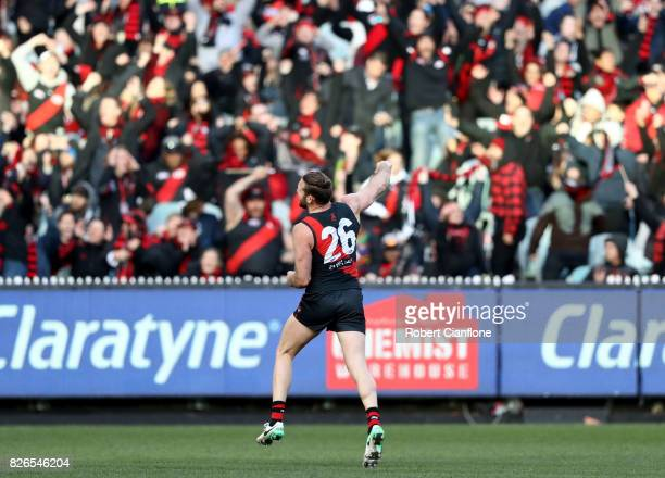 Cale Hooker of the Bombers celebrates after scoring a goal during the round 20 AFL match between the Essendon Bombers and the Carlton Blues at...