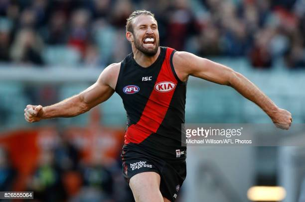 Cale Hooker of the Bombers celebrates during the 2017 AFL round 20 match between the Essendon Bombers and the Carlton Blues at the Melbourne Cricket...