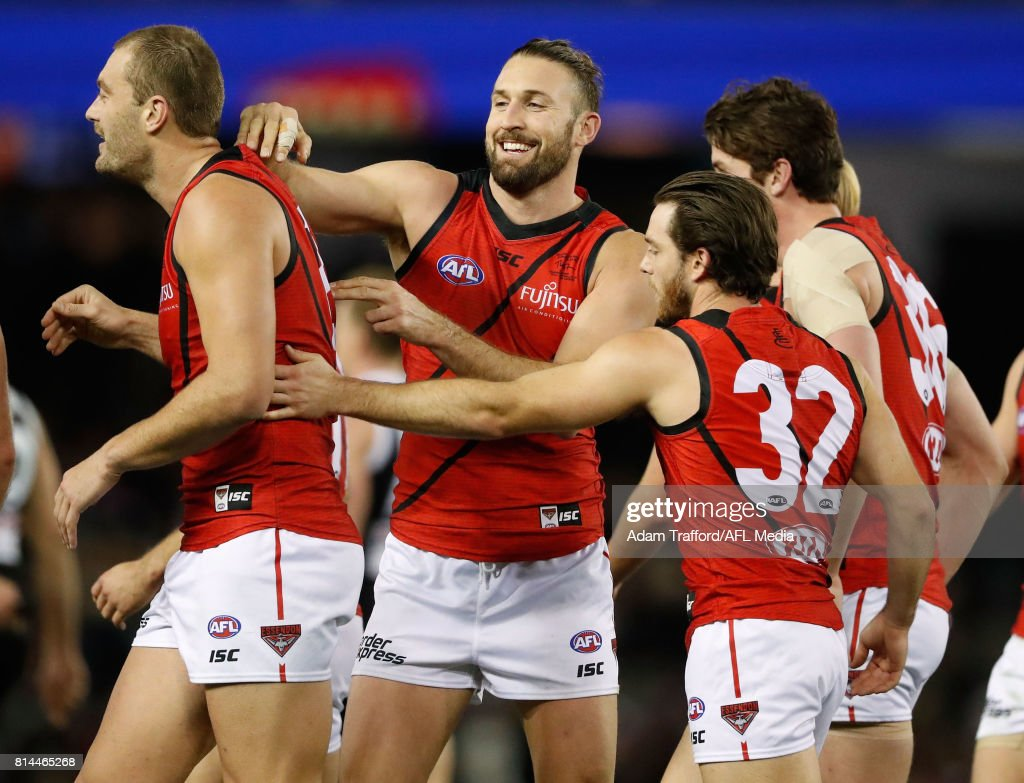 Cale Hooker of the Bombers congratulates Tom Bellchambers of the Bombers (left) on a goal during the 2017 AFL round 17 match between the St Kilda Saints and the Essendon Bombers at Etihad Stadium on July 14, 2017 in Melbourne, Australia.