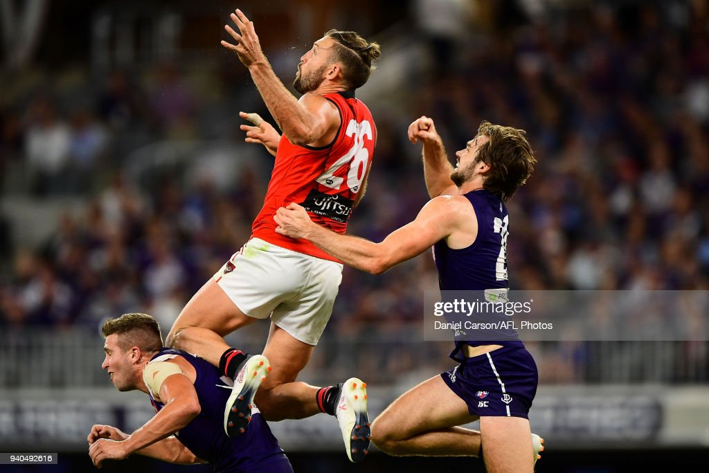 Cale Hooker of the Bombers leaps for a mark attempt during the 2018 AFL round 02 match between the Fremantle Dockers and the Essendon Bombers at Optus Stadium on March 31, 2018 in Perth, Australia.