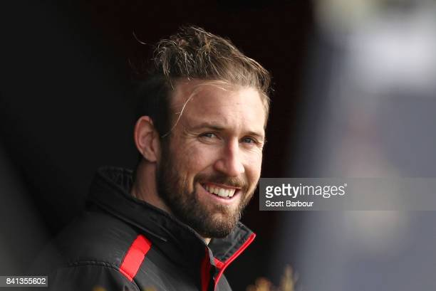 Cale Hooker of the Bombers looks on from inside as players train outside during an Essendon Bombers AFL training session at the Essendon Football...