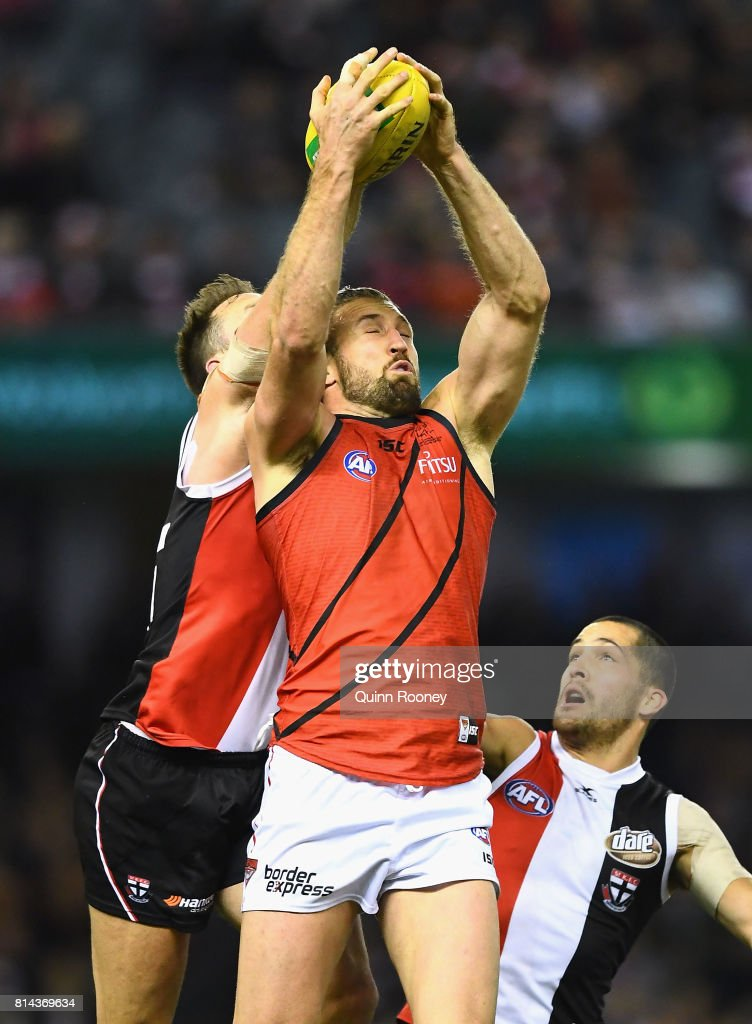 Cale Hooker of the Bombers marks infront of Nathan Brown of the Saints during the round 17 AFL match between the St Kilda Saints and the Essendon Bombers at Etihad Stadium on July 14, 2017 in Melbourne, Australia.
