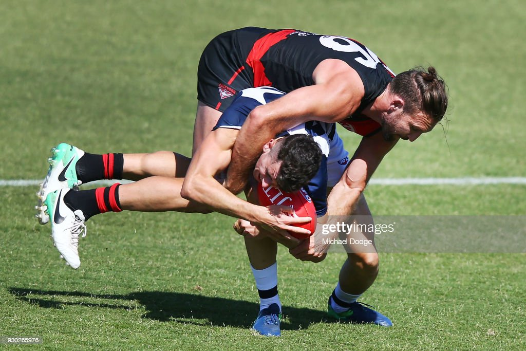Cale Hooker of the Bombers tackles Mark O'Connor of the Cats during the JLT Community Series AFL match between the Geelong Cats and the Essendon Bombers at Central Reserve on March 11, 2018 in Colac, Australia.