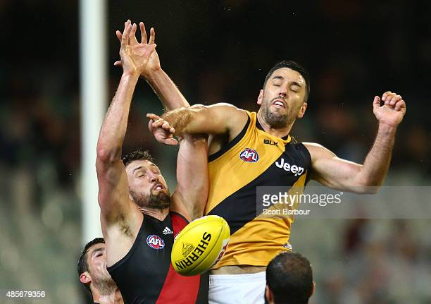 Cale Hooker of the Essendon Bombers and Troy Chaplin of the Richmond Tigers compete for the ball during the round 22 AFL match between the Essendon...