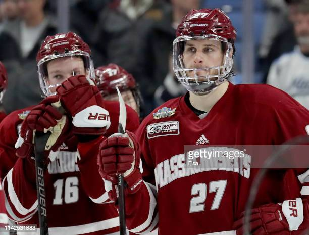 Cale Makar and Jake McLaughlin of the Massachusetts Minutemen react to the loss to the MinnesotaDuluth Bulldogs during the 2019 NCAA Frozen Four the...