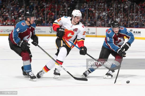 Cale Makar and Tyson Barrie of the Colorado Avalanche skate against Sean Monahan of the Calgary Flames in Game Four of the Western Conference First...