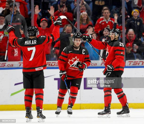 Cale Makar Dillon Dubé and Jordan Kyrou of Canada celebrate Canada's 5th goal of the game during the second period of play in the Quarterfinal IIHF...
