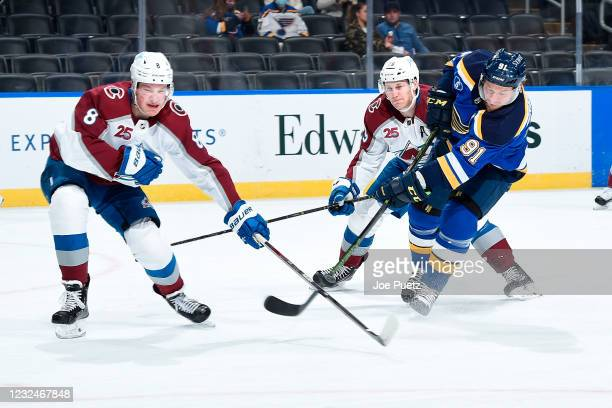 Cale Makar of the Colorado Avalanche attempts to block a shot from Vladimir Tarasenko of the St. Louis Blues on April 22, 2021 at the Enterprise...