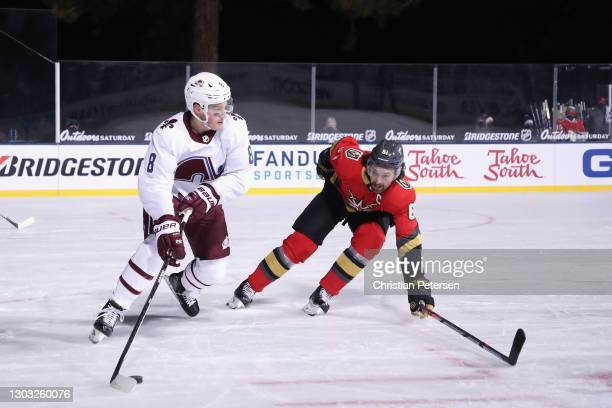 Cale Makar of the Colorado Avalanche carries the puck against Max Pacioretty of the Vegas Golden Knights during the second period during the NHL...