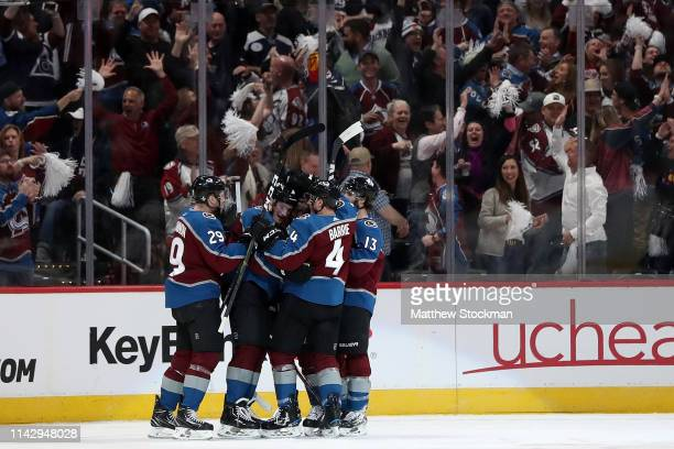 Cale Makar of the Colorado Avalanche celebrates with his teammates after scoring a goal in the first period against the Calgary Flames in Game Three...