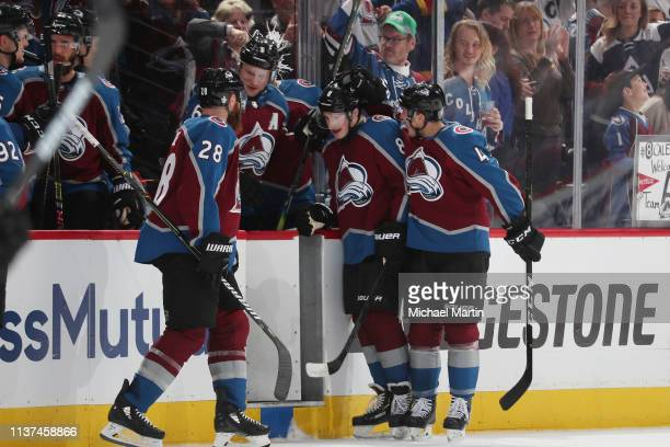 Cale Makar of the Colorado Avalanche celebrates with teammates Ian Cole Erik Johnson and Tyson Barrie after scoring a goal against the Calgary Flames...