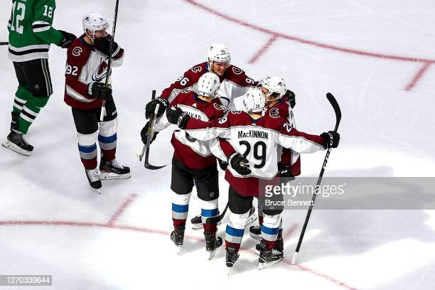 Cale Makar of the Colorado Avalanche is congratulated by his teammates after scoring a goal against the Dallas Stars during the second period in Game...