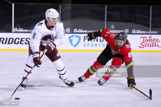 Cale Makar of the Colorado Avalanche looks to pass defended by Mark Stone of the Vegas Golden Knights during the 'NHL Outdoors At Lake Tahoe' at the...