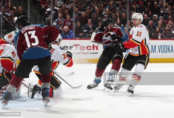 Cale Makar of the Colorado Avalanche scores his first NHL goal against the Calgary Flames in Game Three of the Western Conference First Round during...