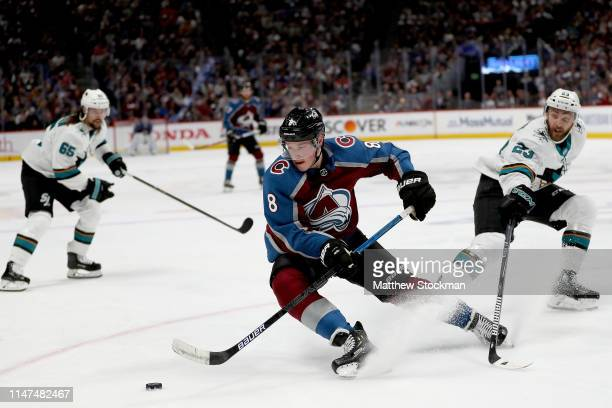 Cale Makar of the Colorado Avalanche skates the puck away from Barclay Goodrow of the San Jose Sharks in the second period during Game Six of the...