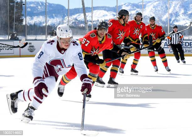 Cale Makar of the Colorado Avalanche skates with the puck away from Max Pacioretty and the Vegas Golden Knights during the first period of the 2021...