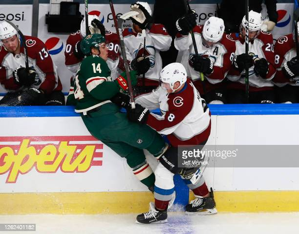 Cale Makar of the Colorado Avalanche steps into Joel Eriksson Ek of the Minnesota Wild during the first period in an exhibition game prior to the...