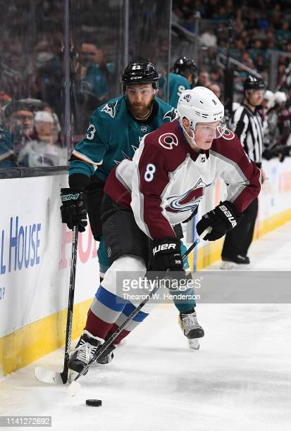 Cale Makar of the Colorado Avalanche takes control of the puck away from Barclay Goodrow of the San Jose Sharks during the first period in Game Five...