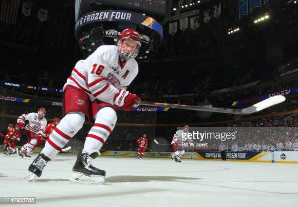 Cale Makar of the Massachusetts Minutemen skates against the Denver Pioneers during the Division I Men's Ice Hockey Semifinals held at KeyBank Center...