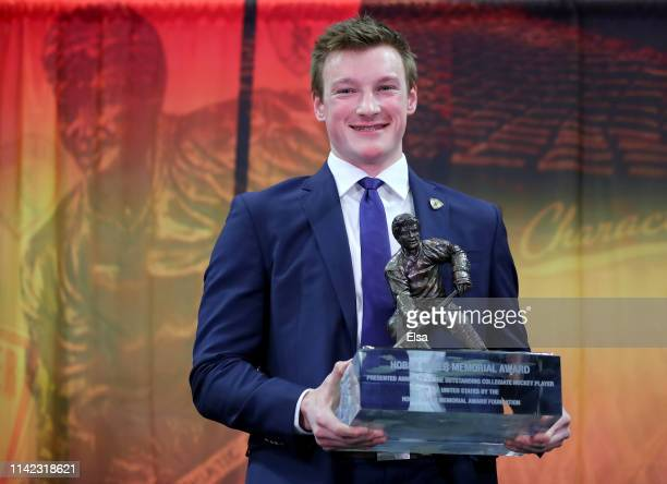 Cale Makar of the University of Massachusetts and winner of the 2019 Hobey Baker Memorial Award poses the trophy after the award ceremony at the...
