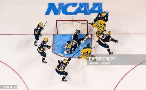 Cale Morris of the Notre Dame Fighting Irish makes a save as teammates Michael Graham Mike OLeary Bobby Nardella Cam Morrison and Tory Dello stand...