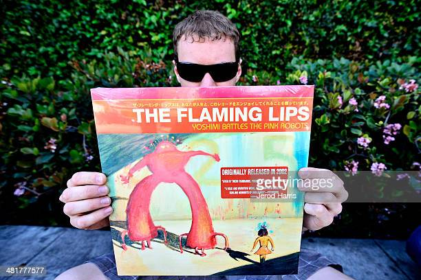 Cale Murray of Los Angeles holds up a copy of his favorite 'Flaming Lips' album while waiting in line for lead singer Wayne Coyne of 'The Flaming...