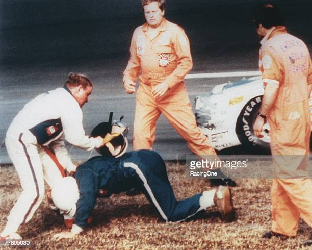 Cale Yarborough in the white hits Bobby Allison with his helmet after the two crashed during the last lap of the 1979 Winston Cup Daytona 500 at the...