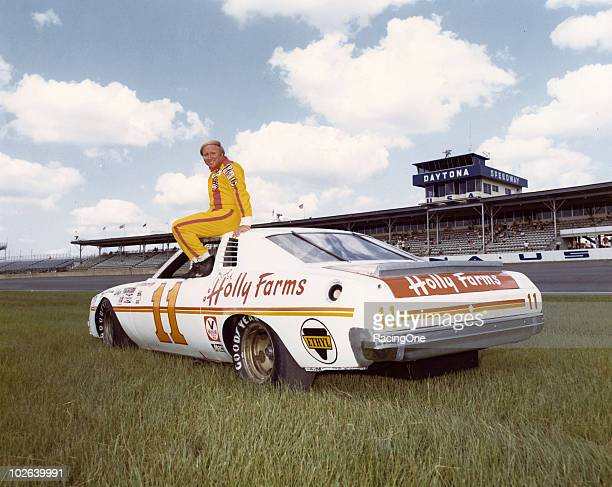 Cale Yarborough poses with his Junior Johnsonowned Holly Farms Chickensponsored Chevrolet at Daytona International Speedway Yarborough finished third...