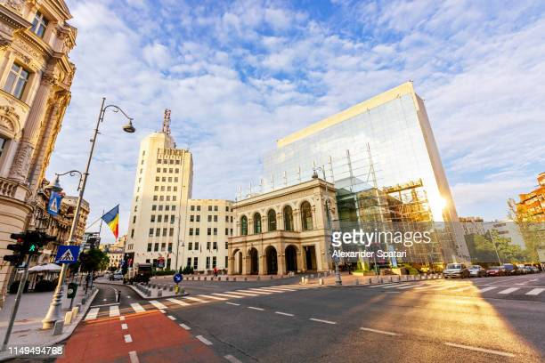 calea victoriei boulevard with modern and old buildings, bucharest, romania - bucharest stock pictures, royalty-free photos & images