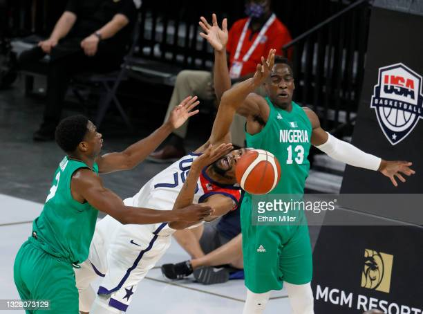 Caleb Agada of Nigeria fouls Kevin Durant of the United States as Miye Oni of Nigeria defends during an exhibition game at Michelob ULTRA Arena ahead...