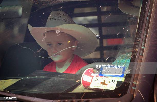 Caleb Chisum waits with his father to unload cattle they will sell at the Abilene Livestock Auction July 26 2011 in Abilene Texas A severe drought in...
