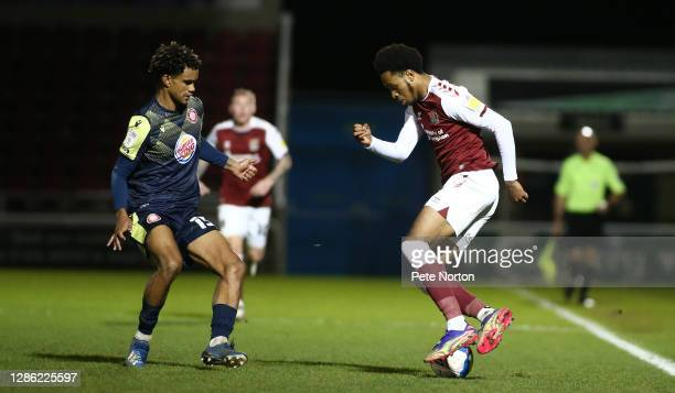 Caleb Chukwuemeka of Northampton Town controls the ball watched by Terence Vancooten of Stevenage during the Papa John's Trophy match between...