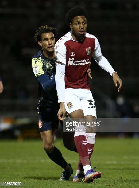 Caleb Chukwuemeka of Northampton Town looks on with Terence Vancooten of Stevenage during the Papa John's Trophy match between Northampton Town and...