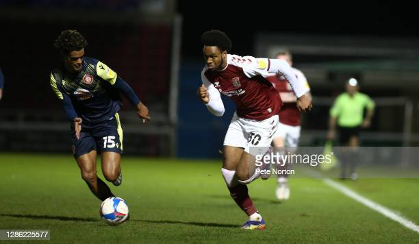 Caleb Chukwuemeka of Northampton Town looks to move with the ball past Terence Vancooten of Stevenage during the Papa John's Trophy match between...