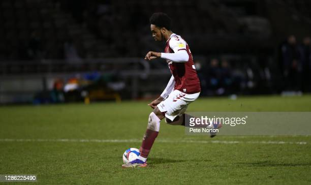 Caleb Chukwuemeka of Northampton Town steps up to score the winning penalty in a shoot out during the Papa John's Trophy match between Northampton...