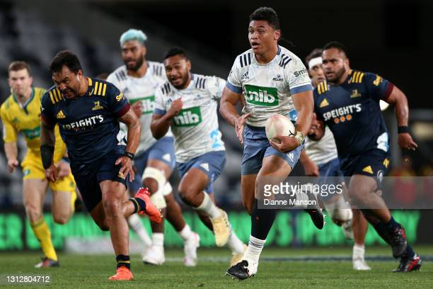 Caleb Clark of the Blues makes a break during the round eight Super Rugby Aotearoa match between the Highlanders and the Blues at Forsyth Barr...