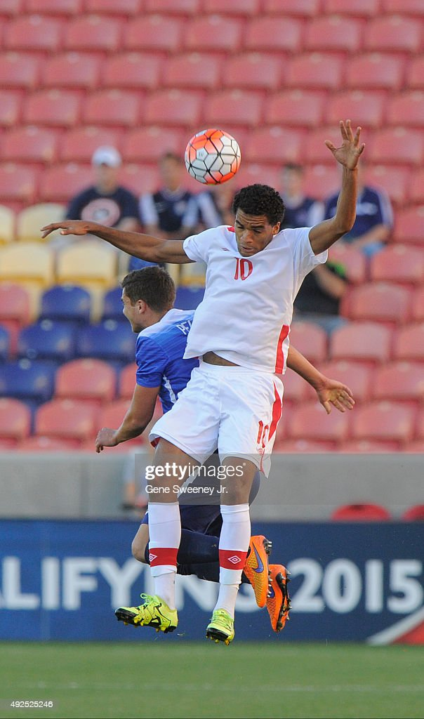 Caleb Clarke #10 of Canada heads the ball away from Marc Pelosi #15 of the United States during the first half of the third place CONCACAF Olympic Qualifying match at Rio Tinto Stadium on October 13, 2015 in Sandy, Utah.